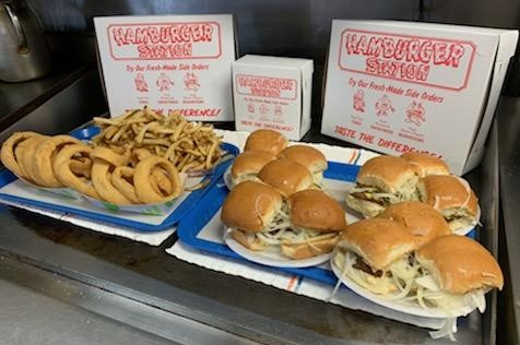 trays of onion rings, french fries, and hamburgers