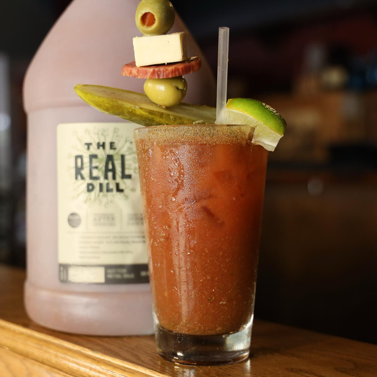 bloody mary with a pickle and olives