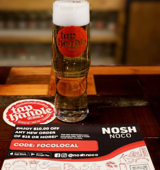 beer glass with a NoshNoco menu