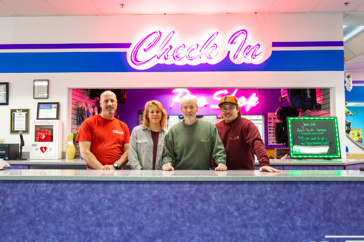 the fitzpatrick family standing at the check in counter