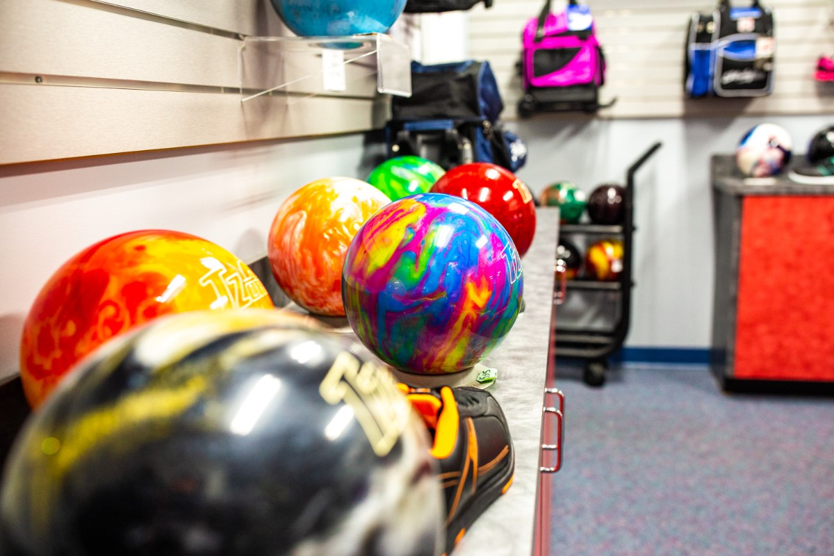 multicolored bowling balls on a rack