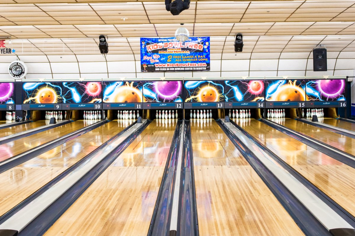 bowling lanes set with bowling pins