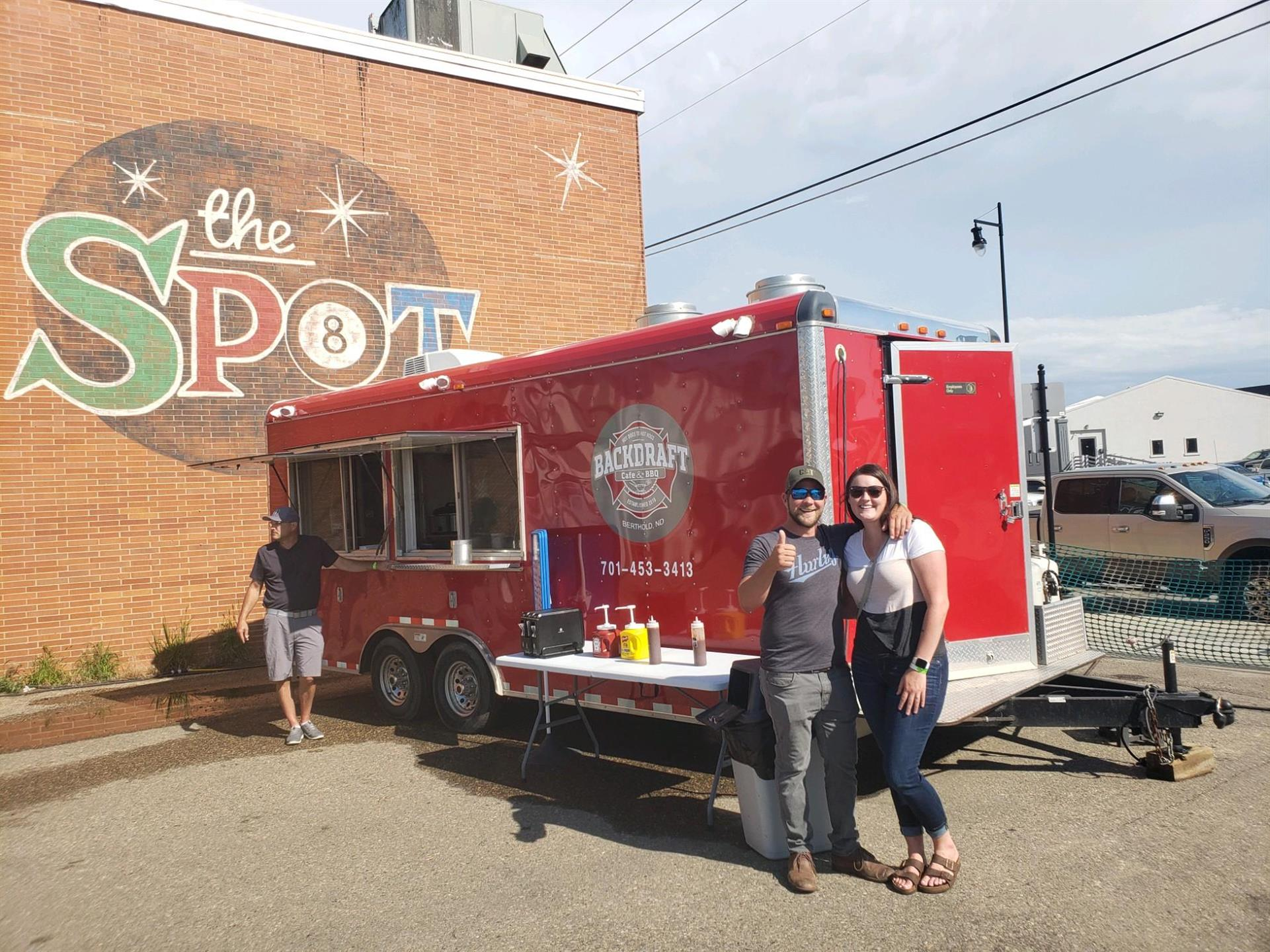 couple posing in front of Food Truck