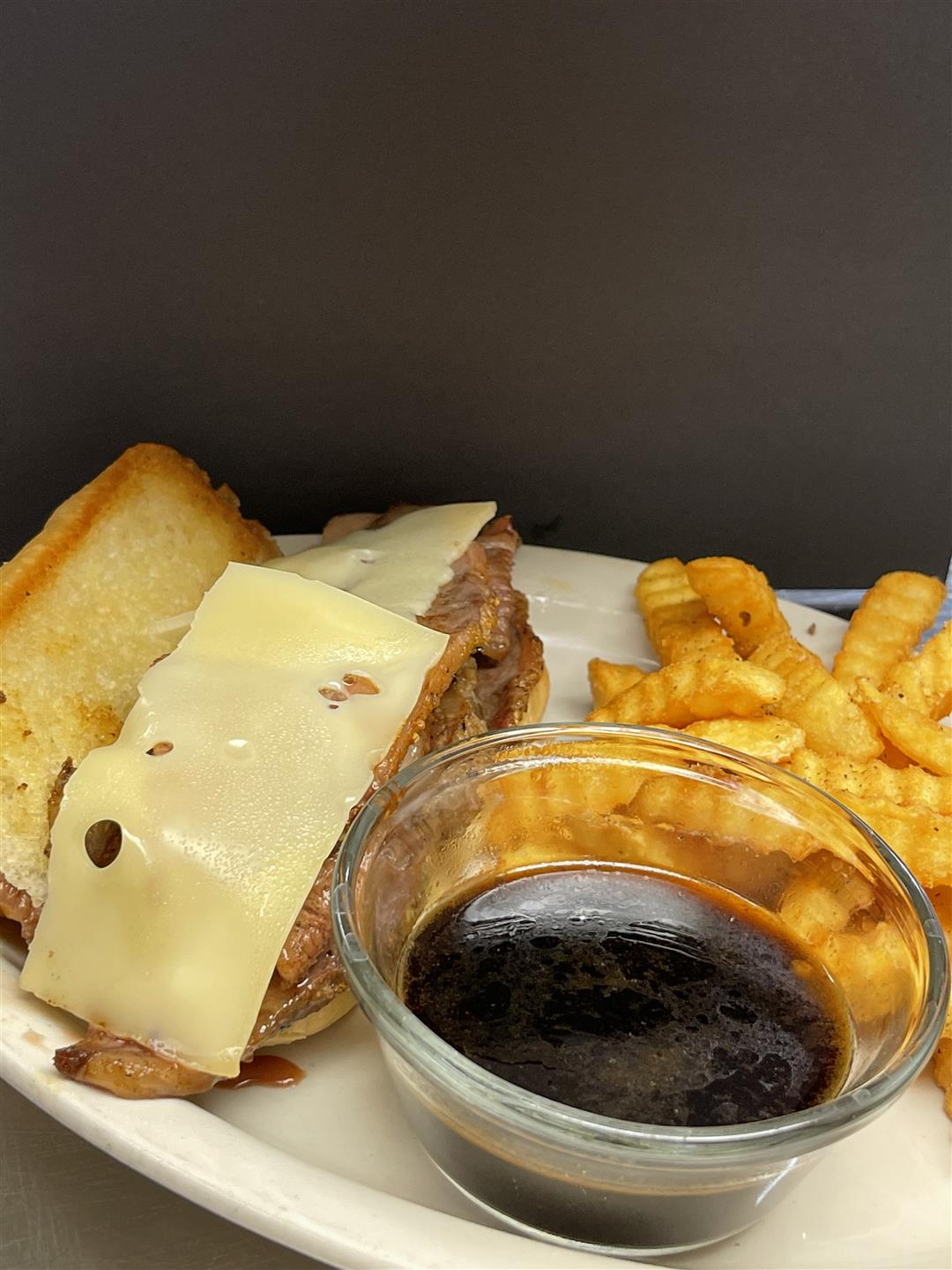 open faced chicken sandwich melt with a side of fries and dipping sauce