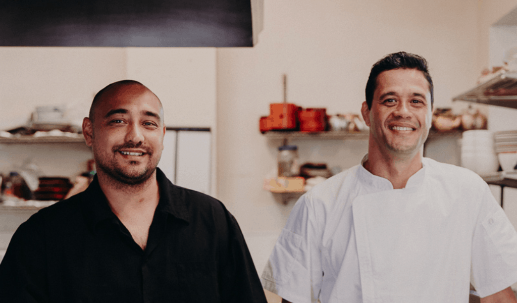 owner and chef smiling