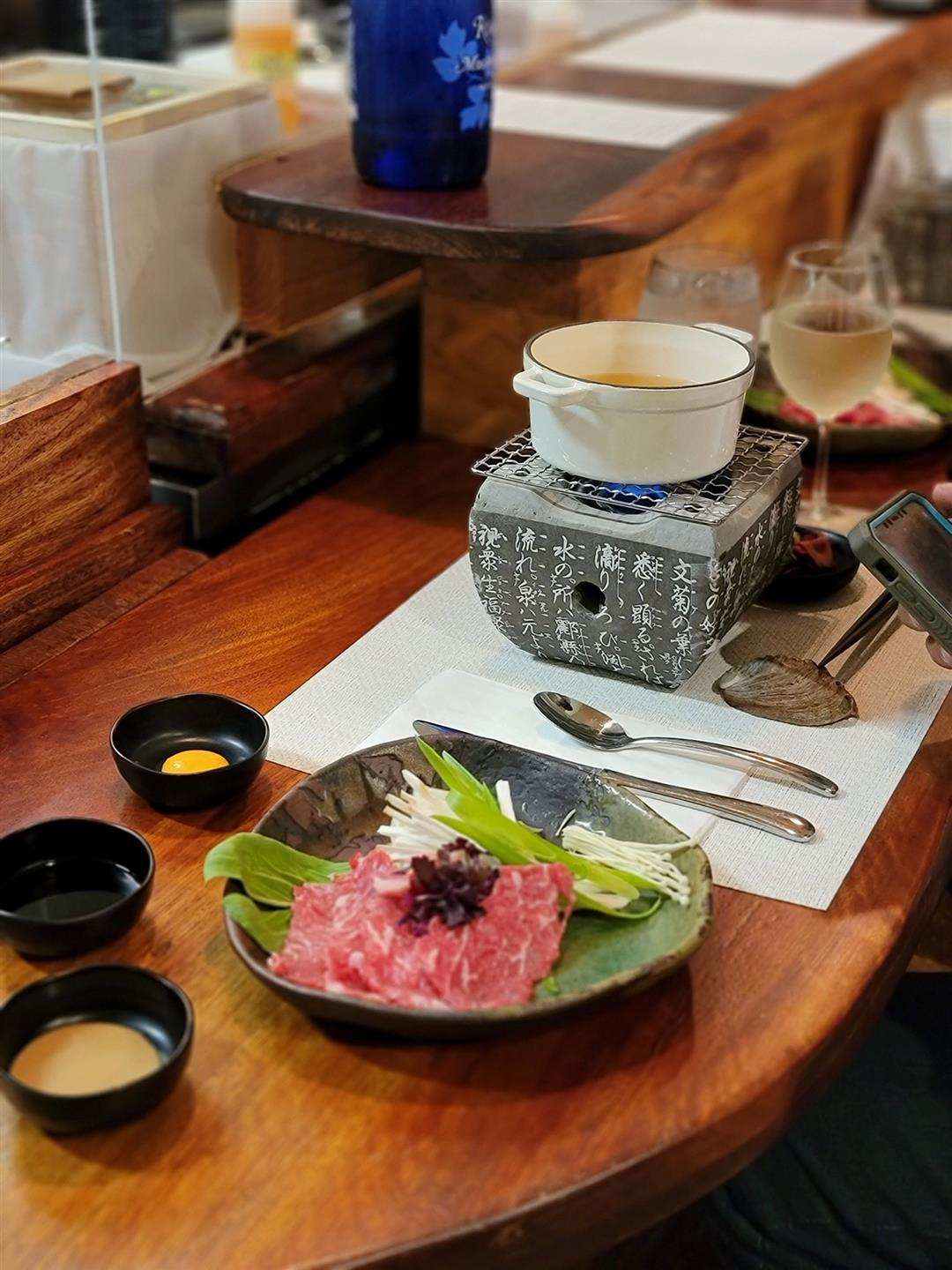 raw waygu beef and toppings