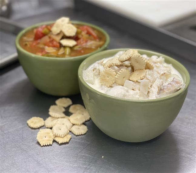 two bowls of soup with crackers