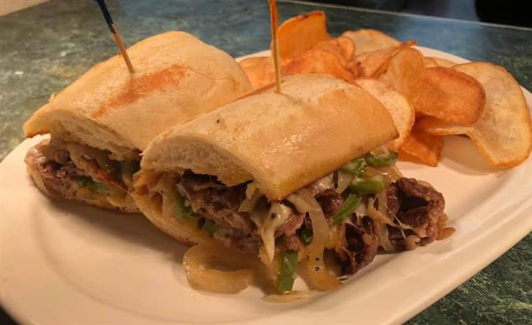 philly cheese steak sandwich with chips