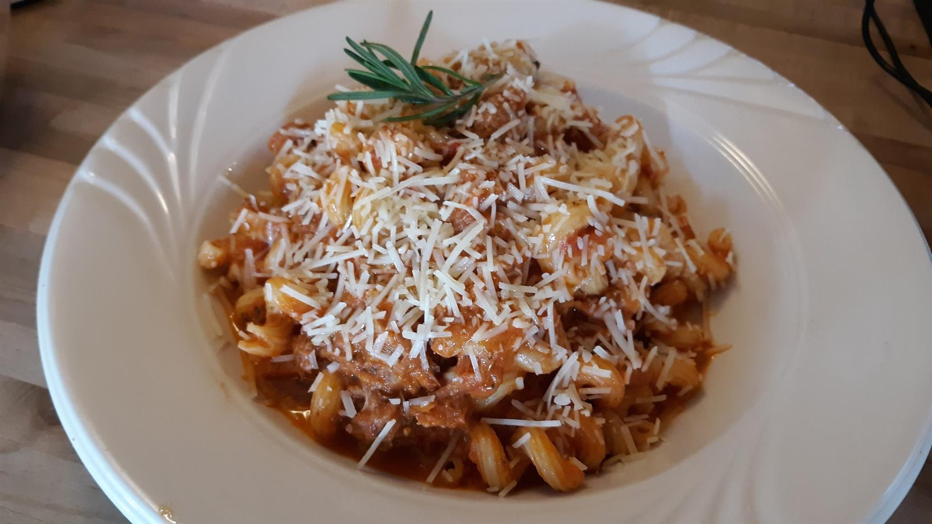 pasta in marinara sauce topped with parmesan