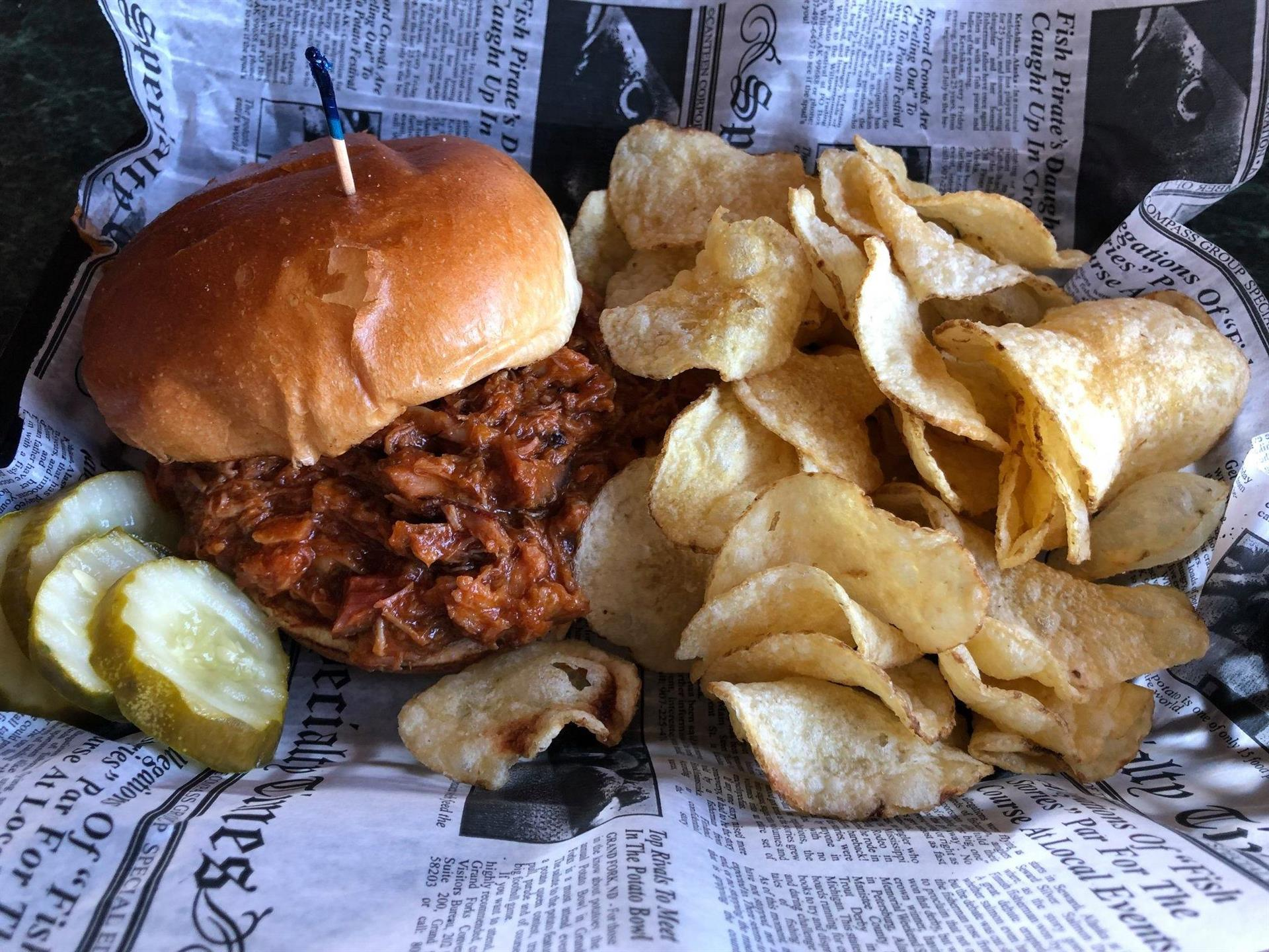 pulled pork sandwich and chips
