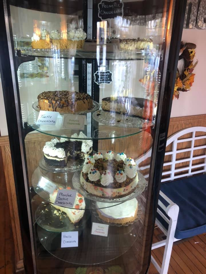 display case of desserts and cakes
