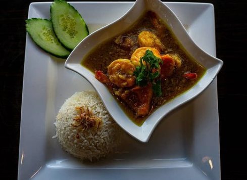 Burmese pumpkin curry with ginger and garlic with shrimp.