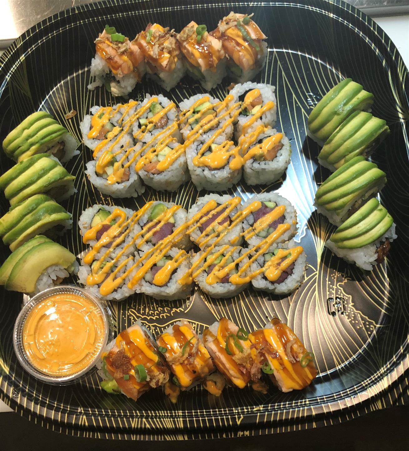 sushi platter with a side of dipping sauce