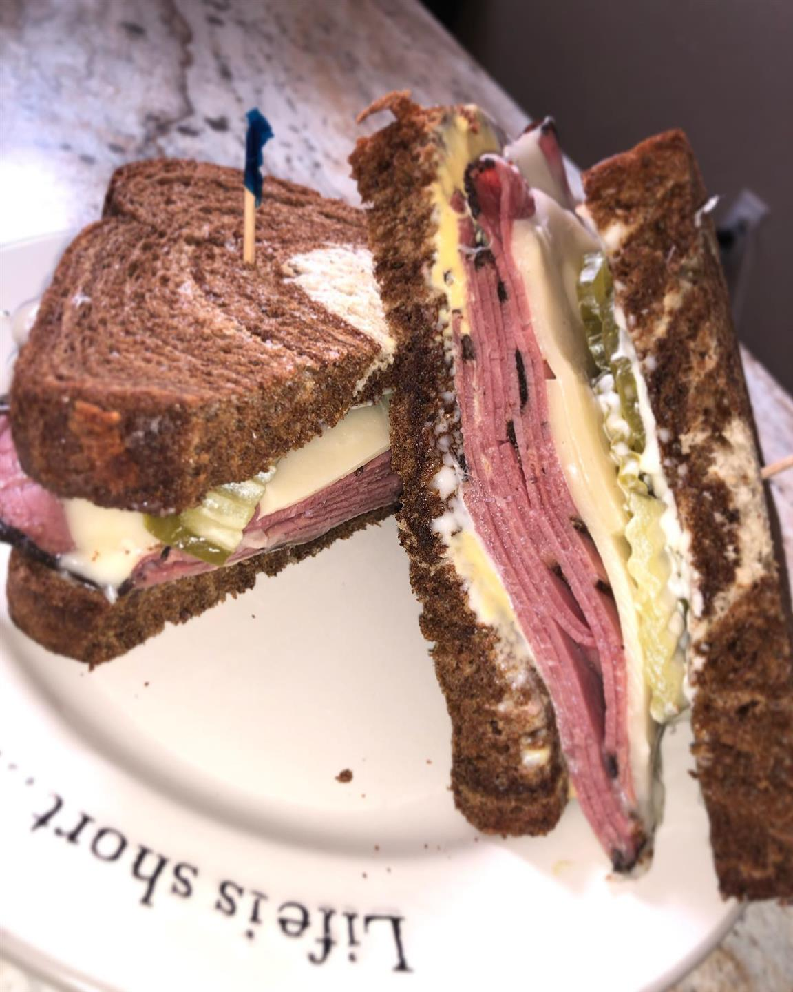 New York Style Pastrami Sandwich: Marble Rye, Pastrami, Swiss, Dill Pickles, Mayo & Dijon