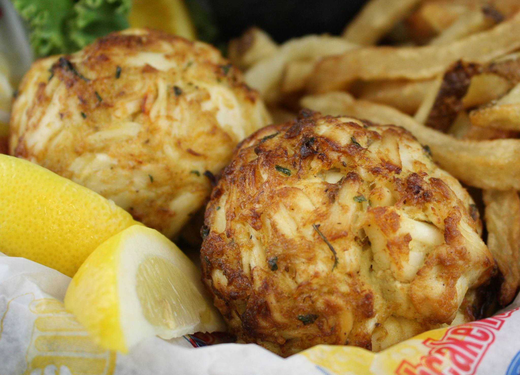 crabcake basket with fries and lemon