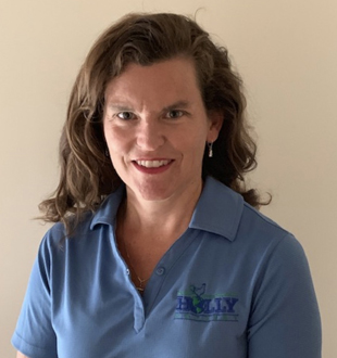 headshot of a woman wearing a blue polo shirt that says Holly Poultry.