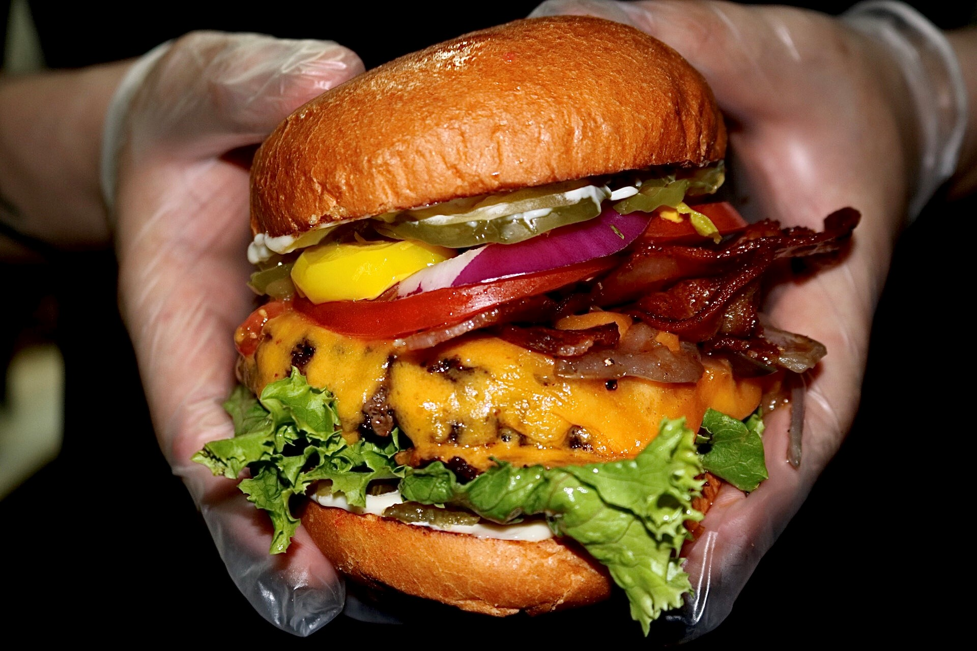 cheeseburger with onion, lettuce, bacon, tomato, pickles and banana peppers