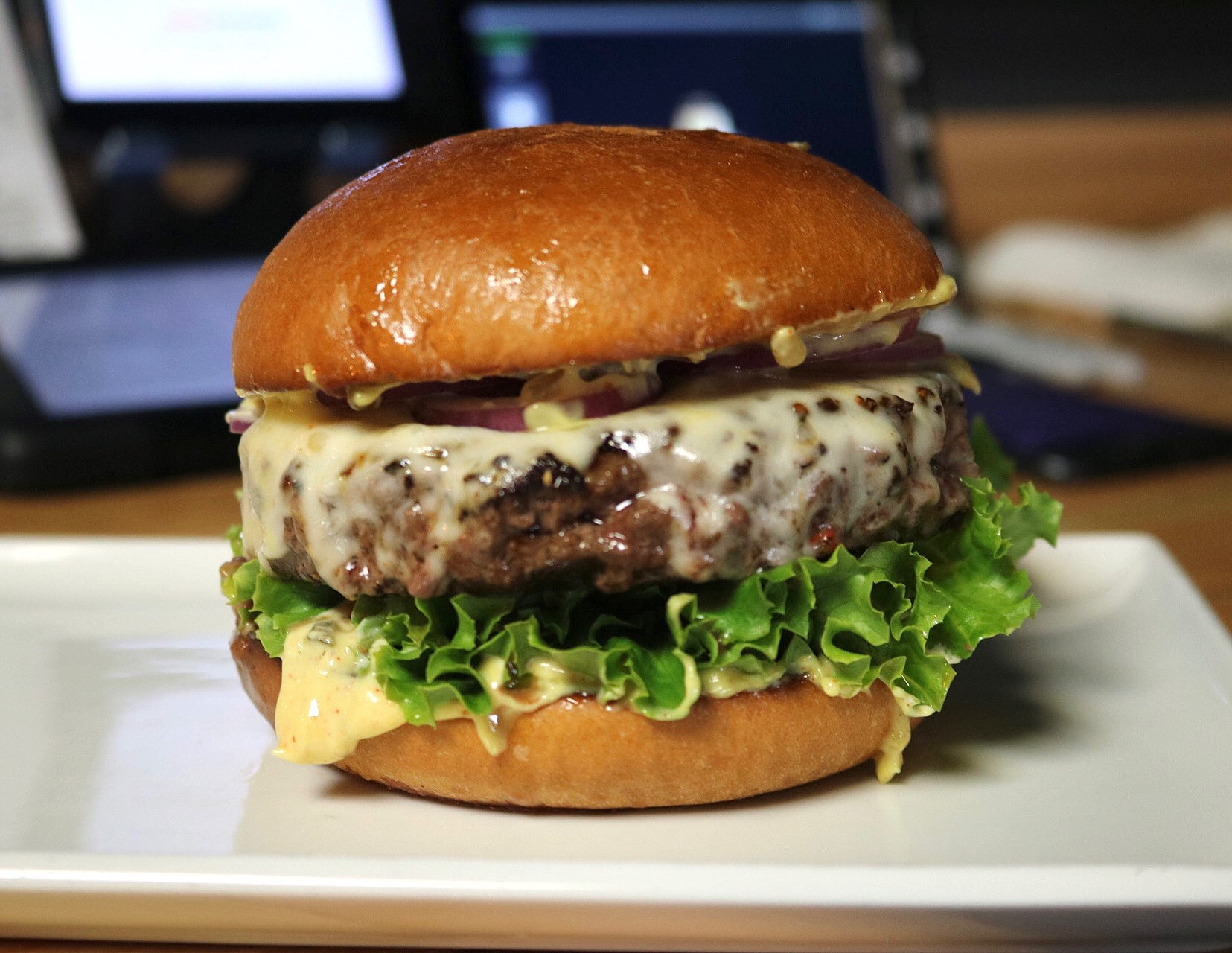 THE HERO – Wagyu Beef Patty, Double Provolone, Green Leaf, Red Onions, Pickles, Hero Sauce, Sriracha, Hidden Sauce