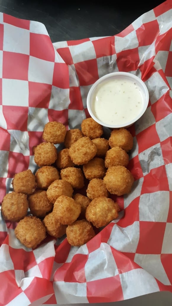 assortment of cheese curds and dipping sauce