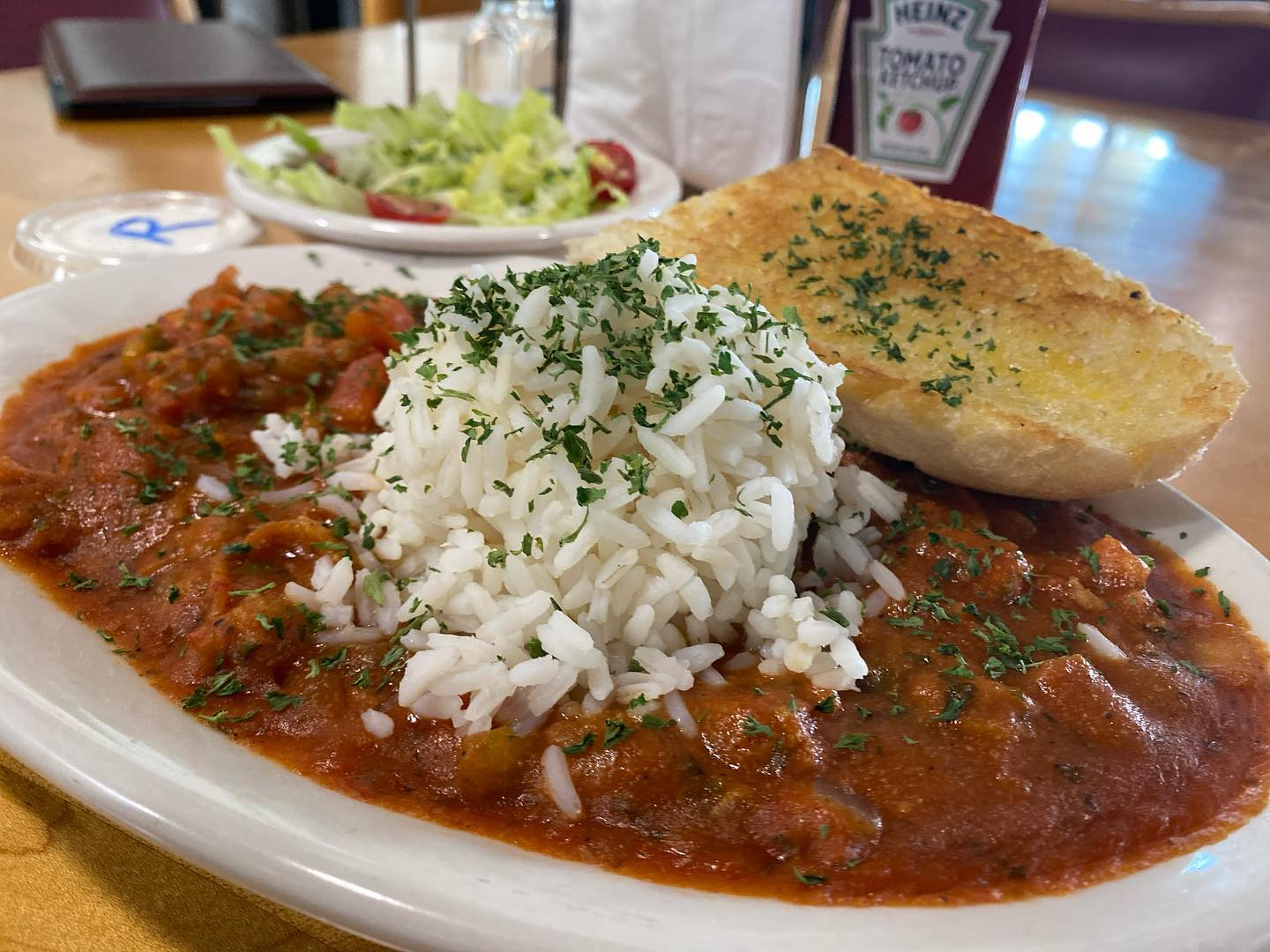 Crawfish Étouffée with rice and a side salad