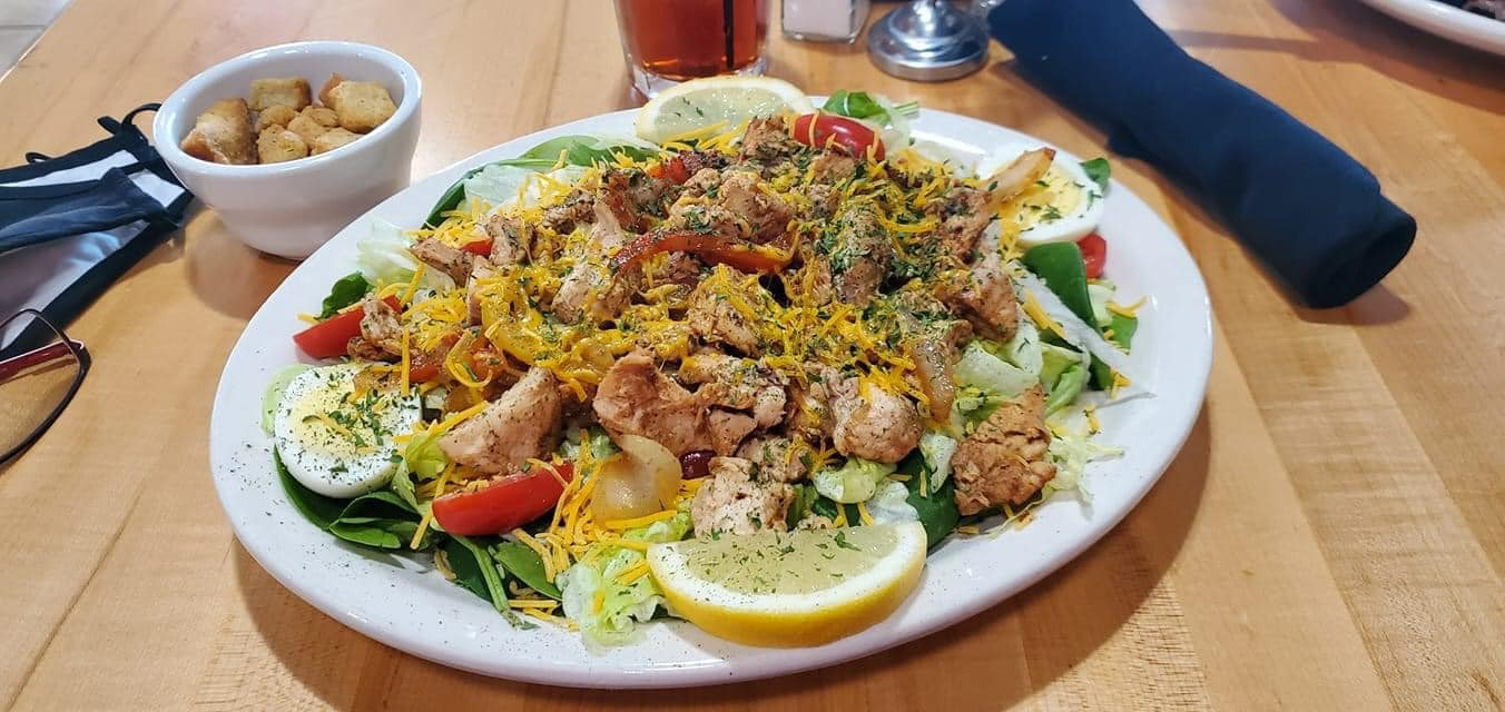 salad topped with chicken
