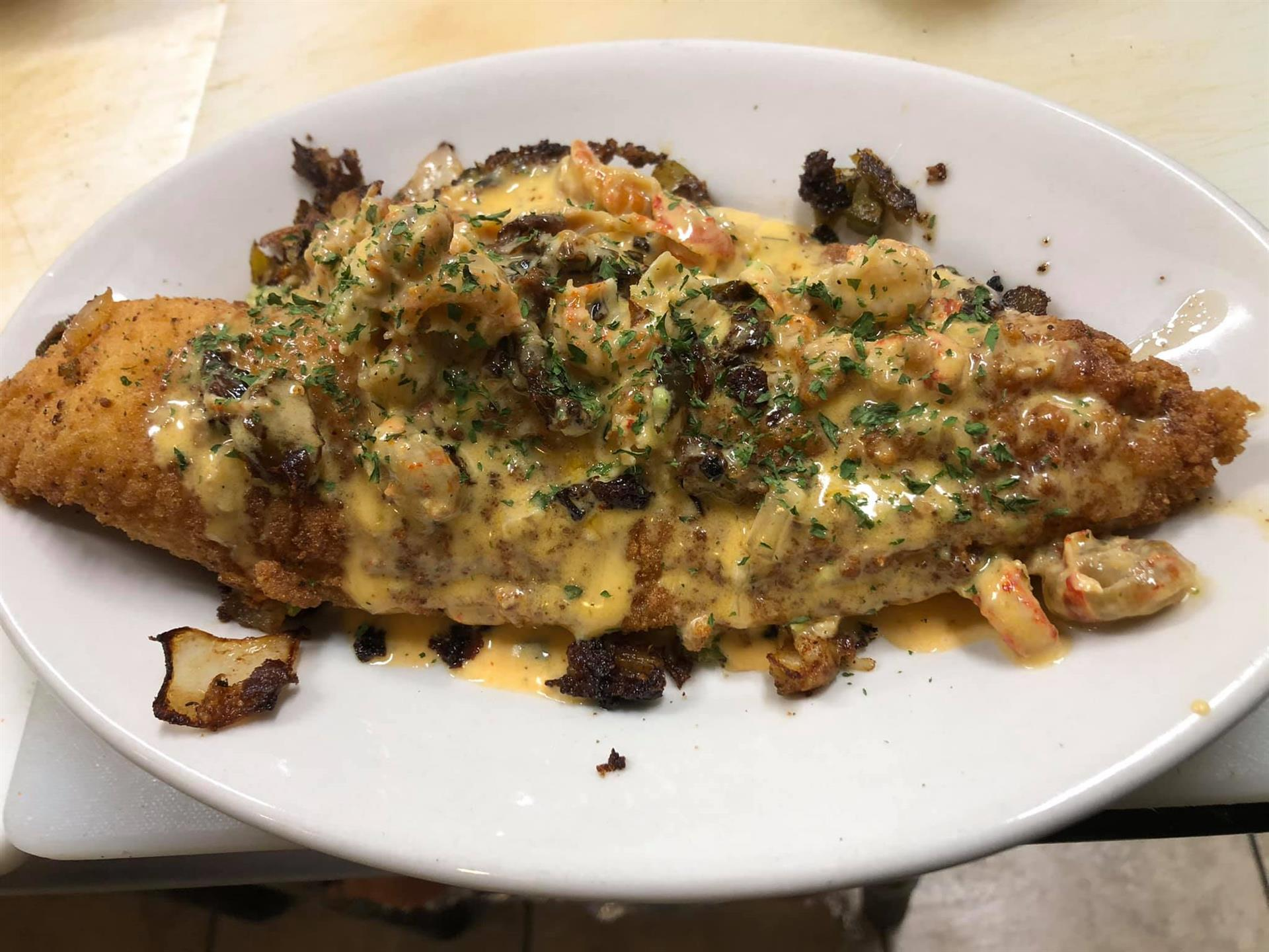 fried fish topped with cajun sauce