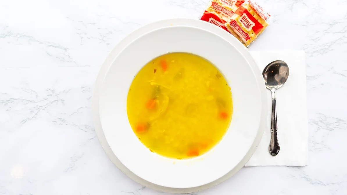 chicken soup with a side of crackers