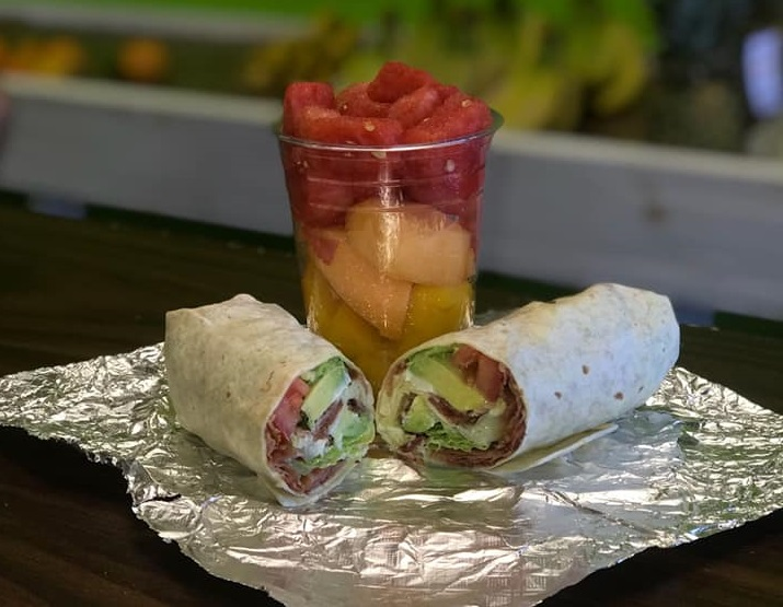 cup of fruit and a wrap on tin foil