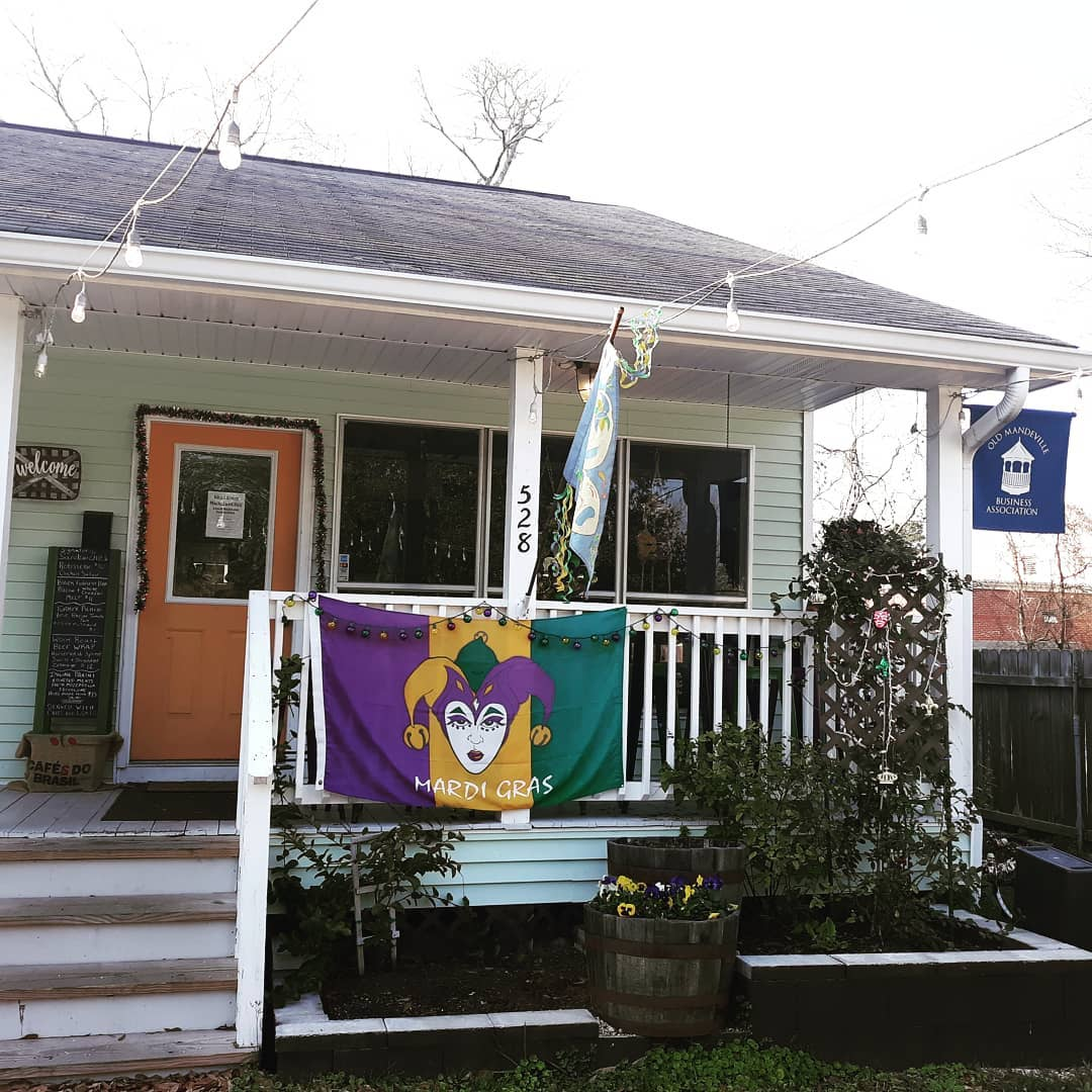 outside of business with mardigras decor