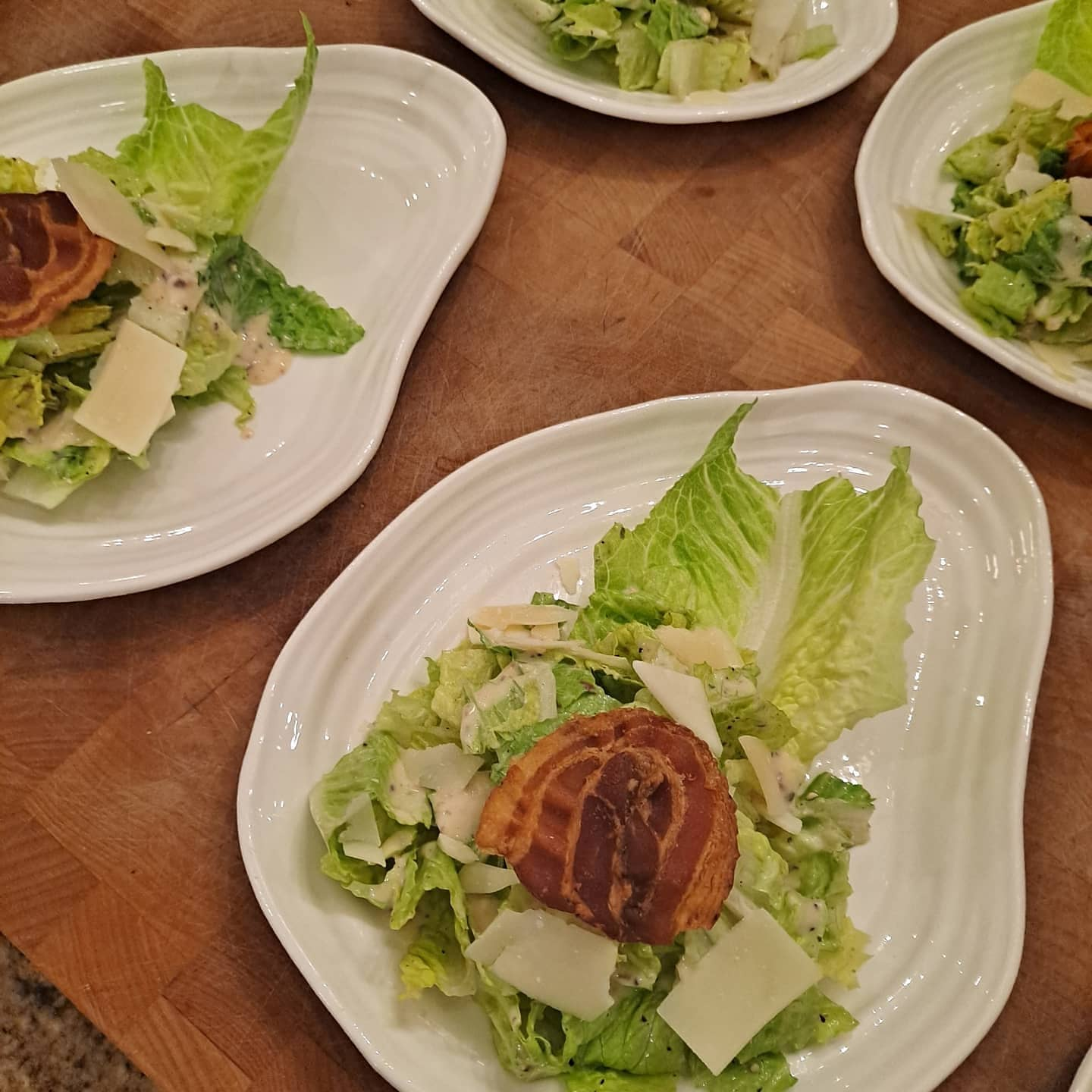 plated salads on a table