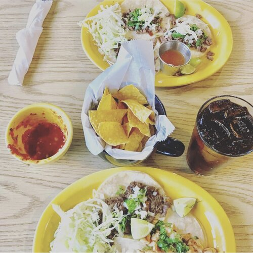 2 plates of tacos, chips and salsa, and soft drink