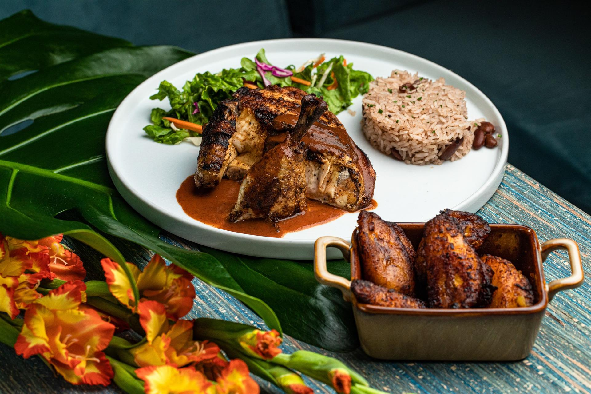 Jerk chicken with rice & peas, house salad ginger honey dressing. Side of sweet plantains