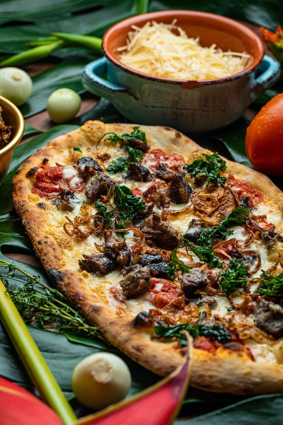 oxtail flatbread with tomato confit, fried onions, blended Italian cheeses