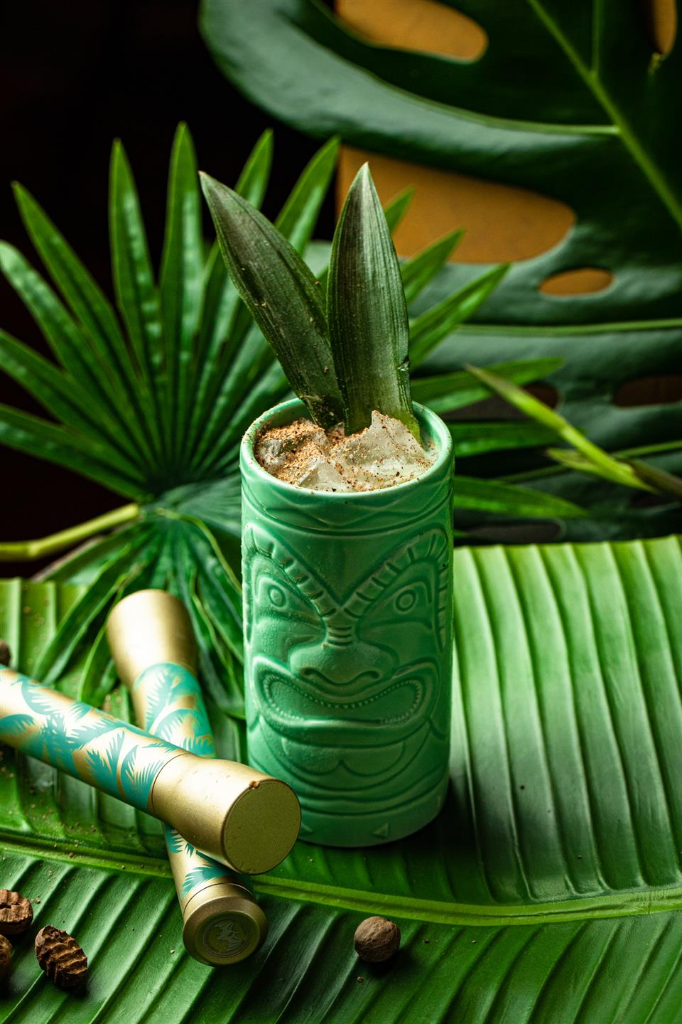 cocktail in a ceramic tiki cup