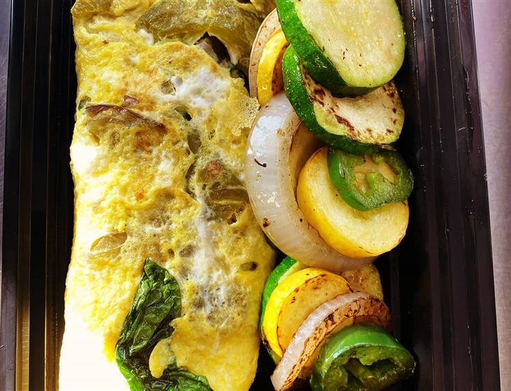 vegetable omelette with vegetables on the side