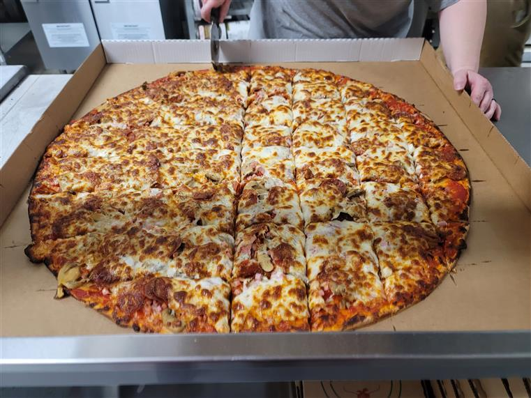 28-inch pizza being cut