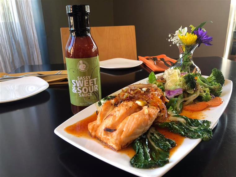 Chef Tammy's bottled Sassy Sweet & Sour Sauce with her popular Spicy Baked Salmon.