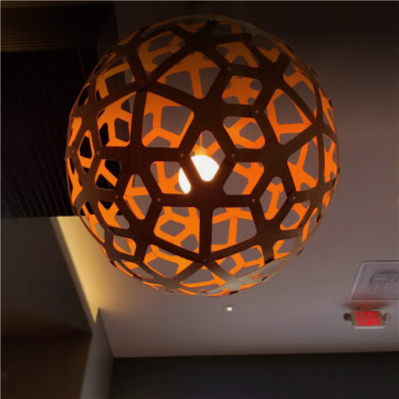 Hanging sphere shaped light fixture with diamond shaped holes