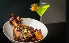 Plate of chicken with martini glass