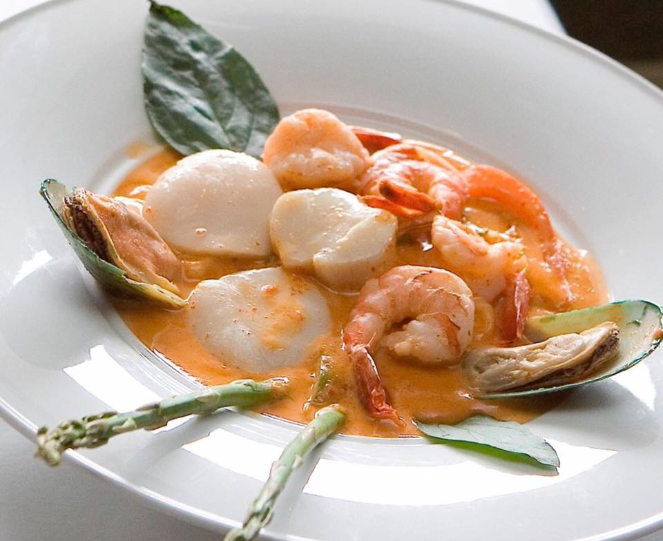 Shrimp and scallop soup with garnish