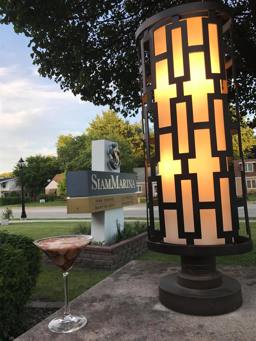 """""""Siam Marina"""" front sign with martini glass and light fixture"""