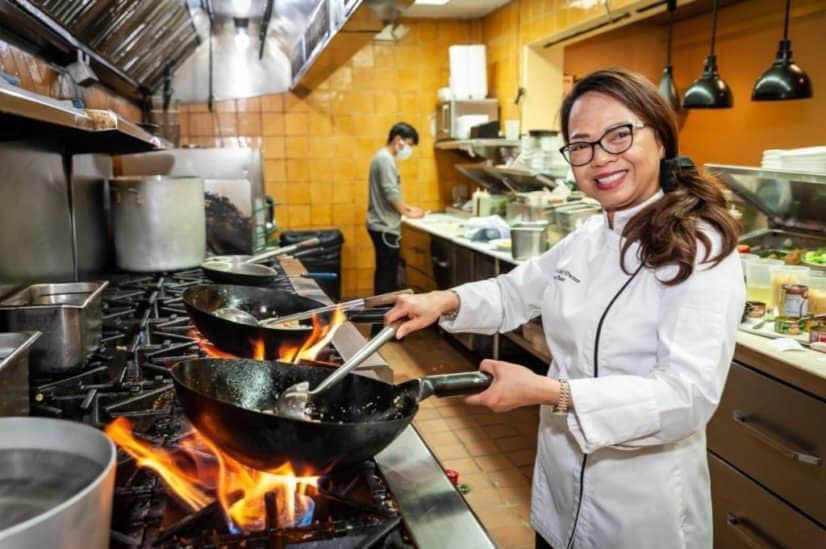 Chef smiling and cooking
