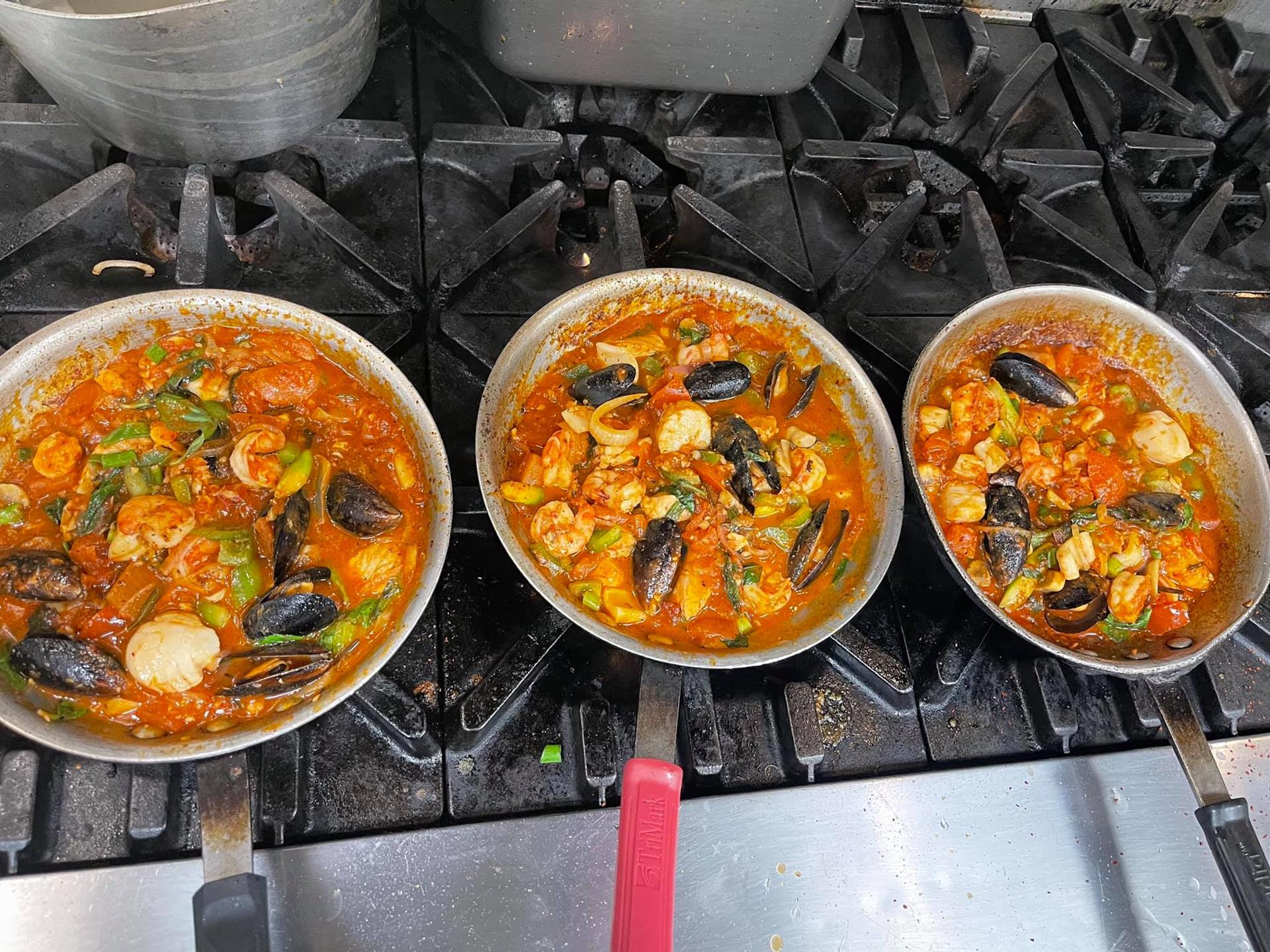 Pots of food cooking on stove