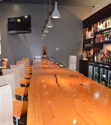 The Bar is made from three sections of a 150-year old cherry tree which was felled by lightening.