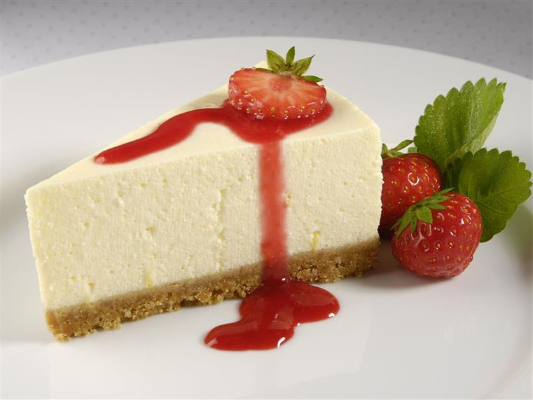slice of cheesecake with a strawberry on top