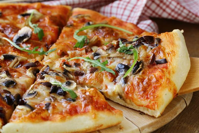 pizza topped with mushrooms