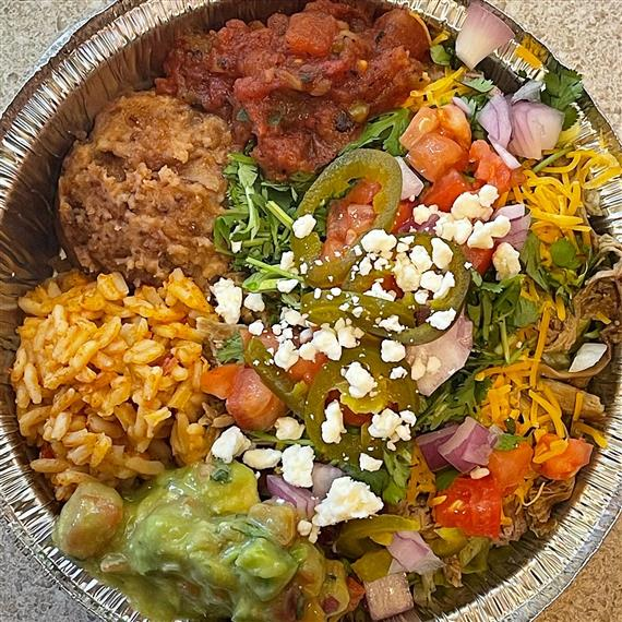 brisket burrito bowl with rice, beans and salsa on the side