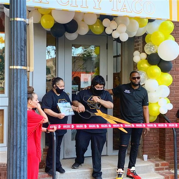 cutting the ribbon for Rock City Taco