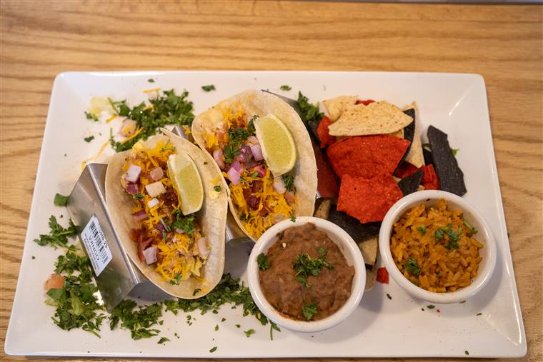 tacos with rice, beans and chips on the side