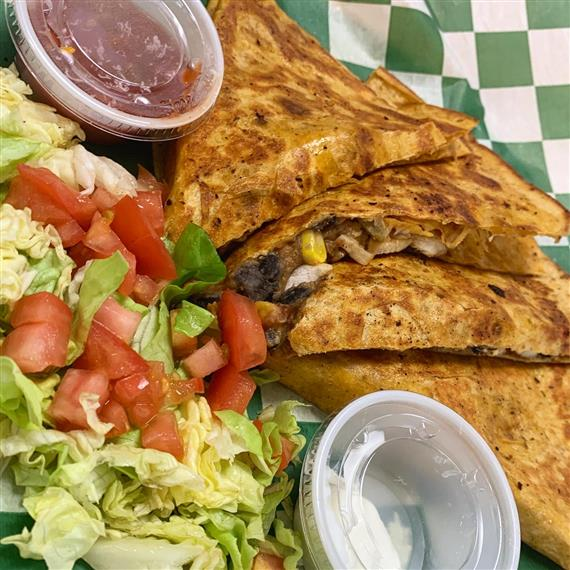 quesadilla with side salad, salsa and sour cream on the side